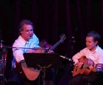Father & Son Performing Guitar