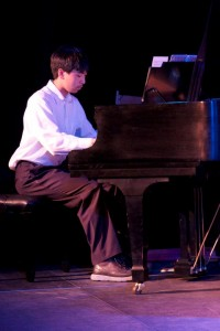 Student who take Piano Lessons Playing Piano
